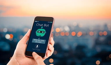 artificial-intelligence-ai-chat-bot-concept-hands-holding-mobile-phone-blurred-urban-city