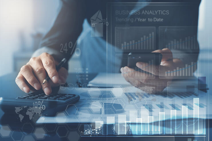 business-man-analysing-market-report-with-business-analytics-dashboard-virtual-screen